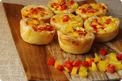 "<a href=""/recipes/387""><img alt=""Titelsschrift"" src=""/system/rectitles/CAPS_Peperoni-Tartelettes.png?1325504662"" /></a>"